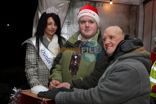 The Rose of Dunleer Kelly McCourt with Johnny Little and Raymond Thores at the Arrival of Santa and the turning on of the Christmas Lights in Dunleer...(Photo credit should read Jenny Matthews www.newsfile.ie)....This Picture has been sent you under the conditions enclosed by:.Newsfile Ltd..The Studio,.Millmount Abbey,.Drogheda,.Co Meath..Ireland..Tel: +353(0)41-9871240.Fax: +353(0)41-9871260.GSM: +353(0)86-2500958.email: pictures@newsfile.ie.www.newsfile.ie.