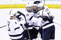 Penn State's Curtis Loik (15) celebrates the opening goal with teammates Mark Yanis (5), Kenny Brooks (13) and David Glen (11). Penn State is leading 1-0 over RIT at Blue Cross Arena in Rochester, New York on October 20, 2012