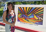 Artist Carrie White displays her work during Artown's Opening Night in Reno on Saturday, July 1, 2017.