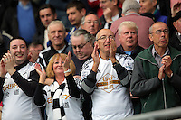 Pictured: Swansea supporters applaud their team's win after the end of the game Sunday 30 August 2015<br />