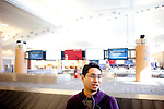 Ryota Kambayashi poses for a portrait in Hartsfield-Jackson Atlanta International Airport in Atlanta, Georgia after a flight from Tokyo, Japan January 6, 2009. Kambayashi said he was asked to take his shoes off in Japan during a screening, which is a new safety measure there.