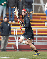 University of Maryland midfielder Beth Glaros (20) brings the ball forward. .University of Maryland (black) defeated Boston College (white), 13-5, on the Newton Campus Lacrosse Field at Boston College, on March 16, 2013.