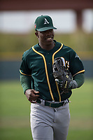 Oakland Athletics left fielder Lazaro Armenteros (13) jogs off the field between innings of a Minor League Spring Training game against the Chicago Cubs at Sloan Park on March 13, 2018 in Mesa, Arizona. (Zachary Lucy/Four Seam Images)