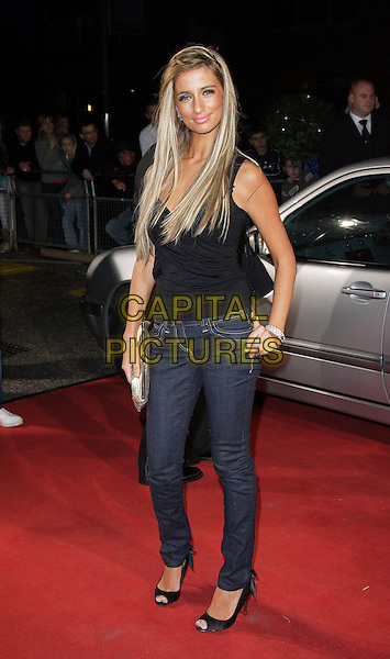 "CHANTELLE HOUGHTON.Celebrity Guests attend ""Another Audience with Al Murray - Pub Landlord"" at London ITV Studios, South Bank, London, England, October 21st 2007..full length black top  blue denim skinny jeans tanned hair extensions gold clutch bag.CAP/ROS.©Steve Ross/Capital Pictures"