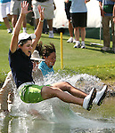 (From left) Lorena Ochoa, along with her father Javier and sister-in-law Paulina, jump into the lake surrounding the 18th green after Ochoa won the Kraft Nabisco Championship at Mission Hills Country Club in Rancho Mirage on Sunday, April 6, 2008. Ochoa finished the day with a five-under-par 67 and a grand total of 11-under-par 277 for the four-round tournament.