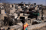 children play outside the Islamabad slum called 'France Colony'