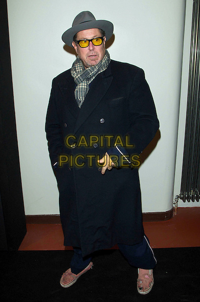 Julian Schnabel.The INTERVIEW Germany Launch Party at Auguststrasse 11, Berlin, Germany..February 8th, 2012.full length pink ripped torn dirty old blue shoes hat grey gray black coat scarf hands in pockets glasses.CAP/PPG/JH.©Jens Hartmann/People Picture/Capital Pictures