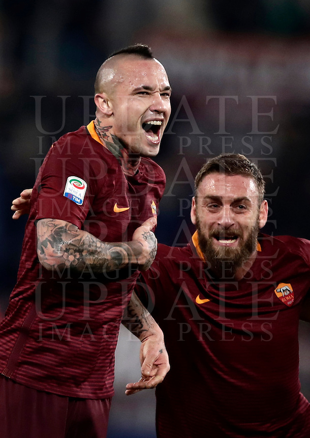 Calcio, Serie A: Roma vs Milan. Roma, stadio Olimpico, 12 dicembre 2016.<br /> Roma's Radja Nainggolan, left, celebrates  with teammate Daniele De Rossi after scoring during the Italian Serie A football match between Roma and AC Milan at Rome's Olympic stadium, 12 December 2016.<br /> UPDATE IMAGES PRESS/Isabella Bonotto