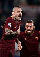 Calcio, Serie A: Roma vs Milan. Roma, stadio Olimpico, 12 dicembre 2016.<br /> Roma&rsquo;s Radja Nainggolan, left, celebrates  with teammate Daniele De Rossi after scoring during the Italian Serie A football match between Roma and AC Milan at Rome's Olympic stadium, 12 December 2016.<br /> UPDATE IMAGES PRESS/Isabella Bonotto