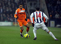 Pictured L-R: Scott Sinclair of Swansea against Jerome Thomas of West Bromwich. Saturday, 04 February 2012<br />