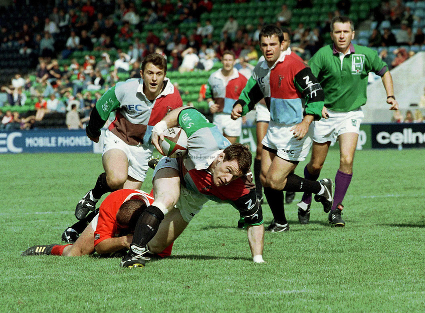 Photo : Ken Brown.7.9.97 Heineken Cup, Harlequins v Munster.Rory Jenkins tries to break the tackle