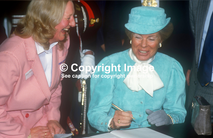 Duchess of Kent shares a joke with Olympic Gold Medalist, Mary Peters during the Duchess&rsquo;s visit to N Ireland February 1986. 1986020506<br /> <br /> Copyright Image from Victor Patterson, 54 Dorchester Park, <br /> Belfast, UK, BT9 6RJ<br /> <br /> t1: +44 28 9066 1296 (from Rep of Ireland 048 9066 1296)<br /> t2: +44 28 9002 2446 (from Rep of Ireland 048 9002 2446)<br /> m: +44 7802 353836<br /> <br /> e1: victorpatterson@me.com<br /> e2: victorpatterson@gmail.com<br /> <br /> www.victorpatterson.com<br /> <br /> Please see my Terms and Conditions of Use at VICTORPATTERSON.COM. It is IMPORTANT that you familiarise yourself with them.<br /> <br /> Images used on the Internet must be visibly watermarked i.e. &copy;VICTORPATTERSON.COM within the body of the image and copyright metadata must not be deleted. Images used on the Internet have a size restriction of 4kbs and are chargeable at the then current NUJ rates.<br /> <br /> This image is only available for the use of the download recipient i.e. television station, newspaper, magazine, book publisher, etc, and must not be passed on to any third party. It is also downloaded on condition that each and every usage is notified within 7 days to victorpatterson@me.com<br /> <br /> The right of Victor Patterson to be identified as the author is asserted in accordance with The Copyright Designs And Patents Act (1988).