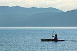 Kayaker paddle in kayak boat on calm blue water of Lake Tahoe, from Kiva Beach, California
