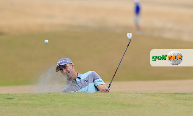 Geoff Ogilvy (AUS) chips from a bunker at the 5th green during Thursday's Round 1 of the 2015 U.S. Open 115th National Championship held at Chambers Bay, Seattle, Washington, USA. 6/18/2015.<br /> Picture: Golffile | Eoin Clarke<br /> <br /> <br /> <br /> <br /> All photo usage must carry mandatory copyright credit (&copy; Golffile | Eoin Clarke)