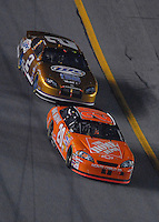 Feb 10, 2007; Daytona, FL, USA; Nascar Nextel Cup driver Tony Stewart (20) leads Kurt Busch (2) during the Budweiser Shootout at Daytona International Speedway. Mandatory Credit: Mark J. Rebilas