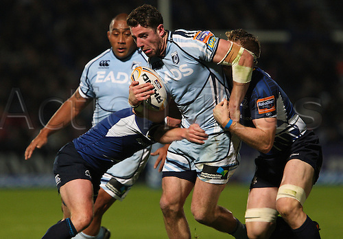 27.10.2012 Dublin, Ireland.  Alex Cuthbert is tackled by Eoin Reddan and Jamie Heaslip, during the RaboDirect PRO12 game between Leinster and Cardiff Blues from the Royal Dublin Society.