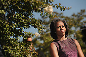 First lady Michelle Obama listens to President Barack Obama speech as he commemorates the 11th anniversary of the 9-11 attacks during a ceremony at the Pentagon, on September, 11, 2012 in Arlington, Virginia..Credit: Olivier Douliery / Pool via CNP
