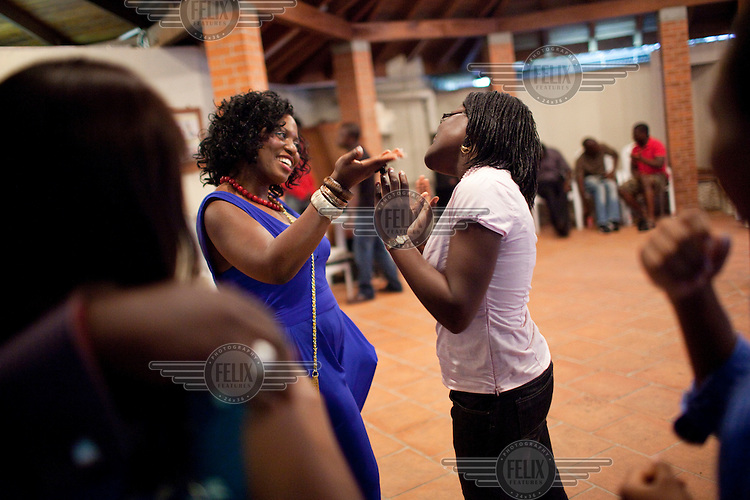 A birthday party in an expensive district of Lagos. Many of the guests are expatriots who have returned from living abroad, known as 'Repats'.