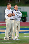 El Segundo, CA 09/27/13 - Two El Segundo coaches watch the Eagles warm up before the game against Oak Park,