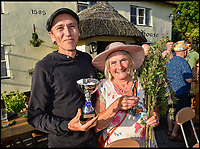 BNPS.co.uk (01202 558833)<br /> Pic: Graham Hunt/BNPS<br /> <br /> Mens champion Tony Jeyes and womens champion Lindie Rogers with their trophies at the World nettle eating championships at the Bottle Inn, Marshwood, Dorset, UK.