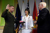 United States Marine General James E. Cartwright is sworn in as the next vice chairman of the Joint Chiefs of Staff by U.S. Secretary of Defense Robert M. Gates with the assistance of his wife Sandee Cartwright at the Pentagon, August 31, 2007.  Cartwright is a target of a Justice Department investigation into a leak of information about a covert U.S.-Israeli cyberattack on Iran's nuclear program.<br /> Mandatory Credit: Cherie A. Thurlby / DoD via CNP