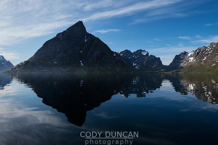 Olstind mountain peak reflects in Reinefjord, near Reine, Moskenesøy, Lofoten Islands, Norway