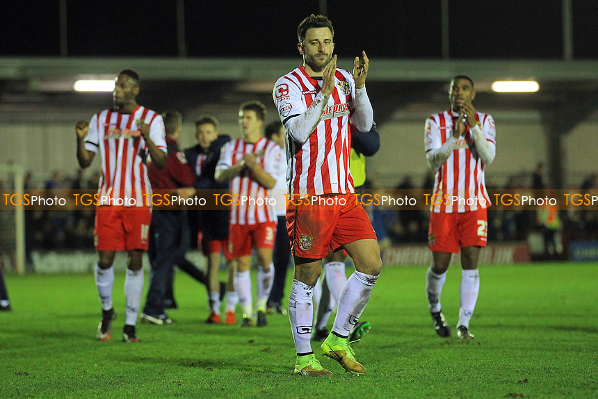 Chris Whelpdale of Stevenage thanks the travelling fans after the game during AFC Wimbledon vs Stevenage, Sky Bet League 2 Football at the Cherry Red Records Stadium, Kingston, England on 12/12/2015