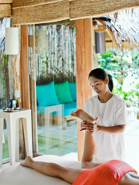 A woman receives a Fusion Massage in Treatment Room 5 at Six Senses Spa. The Fusion Massage is an 80-minute treatment combining Swedish, Thai, Aromatherapy and Sports massages. Thailand.