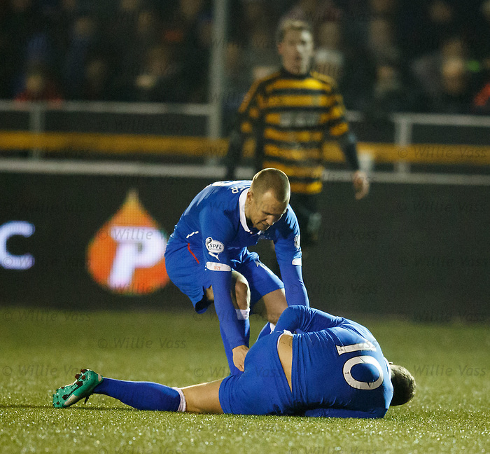Lewis Macleod falls down clutching his left hamstring as a worried Kenny Miller rushes to his aid