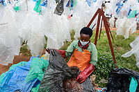 RWANDA, Kigali, plastic recycling at company ecoplastics, worker clean and dry plastic foils before processing to granulate which is used for new plastic products / RUANDA, Kigali, plastic recycling bei Firma Ecoplastics, Sortierung, Reinigung und Trocknung von alten Folien bevor sie zu Granulat recycelt werden