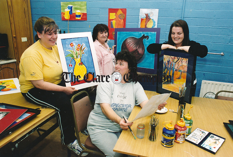 Trainees Ann McDonagh, Margaret McDonagh, Teresa McDonagh and art teacher, Imelda Greene putting the final touches to their paintings for the forthcoming St Joseph's Training Centre First Annual Art and Craft Exhibition at the DeValera Library, Ennis - July 2, 1999. Photograph by John Kelly