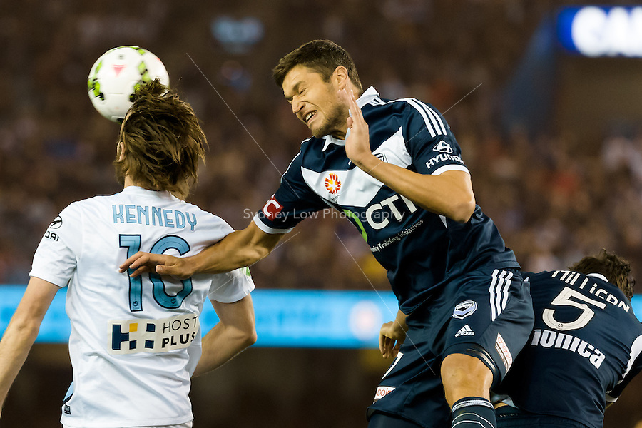 Joshua Kennedy of City and Mathieu Delpierre of the Victory jump for the ball in the semi final match between Melbourne Victory and Melbourne City in the Australian Hyundai A-League 2015 season at Etihad Stadium, Melbourne, Australia.<br />