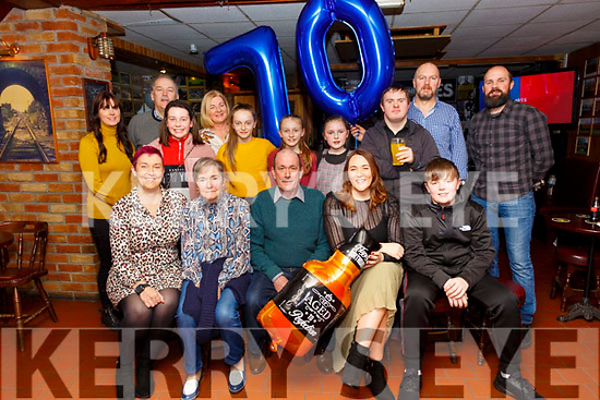 Double  BirthdayCelebration: Father and daughter Martin Griffin, Listowel, centre and Rochelle O'Riordan , Moyvane second from right seated celebrating their 70th & 40th birthdays respectively at Mike the Pies Bar on Saturday evening last.