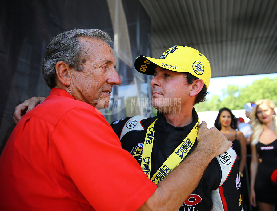Jun 11, 2017; Englishtown , NJ, USA; NHRA top fuel driver Steve Torrence (right) is congratulated by Don Schumacher after winning the Summernationals at Old Bridge Township Raceway Park. Mandatory Credit: Mark J. Rebilas-USA TODAY Sports