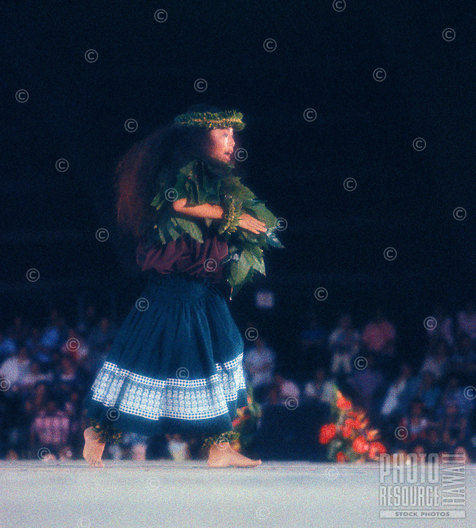 Lisa Doi, winner at the Merrie Monarch festival performing an ancient form of hula called Kahiko hula.  Kumu: Lum Ho