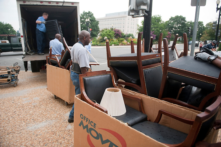 UNITED STATES - JULY 6: U.S. Capitol workers load chairs into a truck outside of the Russell Senate Office Building on Wednesday, July 6, 2011. (Photo By Bill Clark/Roll Call)