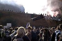 Roma,15 Ottobre 2011.Manifestazione contro la crisi e l'austerità..Corteo e scontri con le forze dell'ordine.Manifestanti invadono i fori imperiali dalla Basilica di Massenzio
