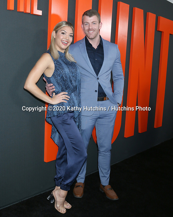 """LOS ANGELES - MAR 9:  Giannina Gibelli, Damian Powers at the """"The Hunt"""" Premiere at the ArcLight Hollywood on March 9, 2020 in Los Angeles, CA"""