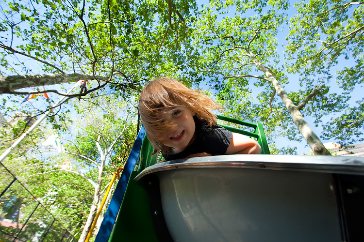 Little Girl playing in a slide in a park
