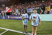 Portland, Oregon - Saturday July 2, 2016: The Girls Inc. Girls of the Game hold roses for the goal scorers during a regular season National Women's Soccer League (NWSL) match at Providence Park.