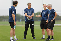Pictured: (L-R) David Tivey, first team fitness coach for Swansea City, Martyn Margetson, goalkeeping and set piece coach for Swansea City Steve Cooper Head Coach of Swansea City and Mike Marsh, assistant first team coach for Swansea City during the Swansea City FC training session at the Fairwood training ground in Swansea, Wales, UK Saturday 29 June 2019Saturday 29 June 2019<br /> Re: Swansea City FC training, Fairwood, near Swansea, Wales, UK