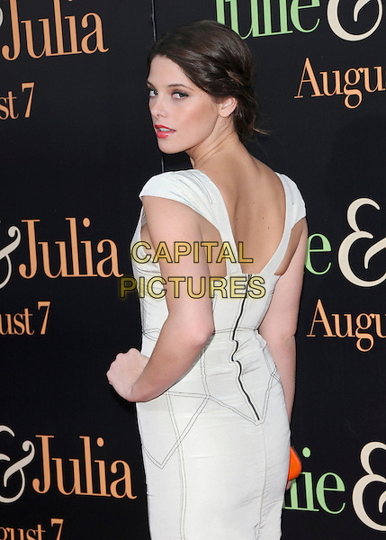 """ASHLEY GREENE .at The Columbia Pictures' Screening of  """"Julie & Julia"""" held at The Mann's Village Theatre in Westwood, California, USA, July 27th 2009.                                                                   .half length white dress zip back over shoulder hand on hip rear behind looking .CAP/DVS.©Debbie VanStory/RockinExposures/Capital Pictures"""