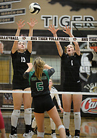 NWA Democrat-Gazette/ANDY SHUPE<br /> Van Buren's Grace Doolittle (5) sends the ball over the net Tuesday, Sept. 10, 2019, as Bentonville's Molly O'Dell (13) and Callie Neumann (1) defend during play in Tiger Arena in Bentonville. Visit nwadg.com/photos to see more photos from the match.