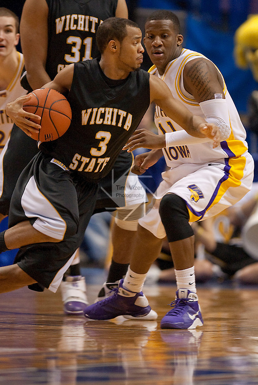 March 7,  2010          Wichita State guard Clevin Hannah (3) drives past Northern Iowa guard Kwadzo Ahelegbe (11) in the second half.  Both were named to the All-Tournament Team and Ahelegbe was also named Most Outstanding Player.   The University of Northern Iowa defeated Wichita State 67-52 on Sunday March 7, 2010 in the championship game of the Missouri Valley Conference Tournament at the Scottrade Center in downtown St. Louis.   They automatically earn a berth in the NCAA Tournament.