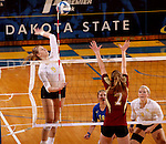 BROOKINGS, SD - OCTOBER 3:  Carley Gerving #9 from South Dakota State University looks to get a kill past Nola Basey #7 from Denver in the second game of their match Friday night at Frost Arena. (Photo/Dave Eggen/Inertia)
