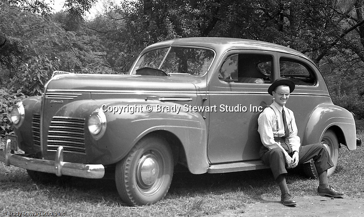 Wilkinsburg PA:  Brady Stewart Jr. with his new Plymouth 2-door Sedan - 1940.