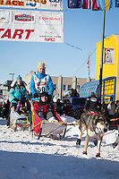 Marcelle Fressineau and team leave the ceremonial start line at 4th Avenue and D street in downtown Anchorage during the 2014 Iditarod race.<br /> Photo by Jim R. Kohl/IditarodPhotos.com