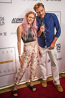 Turtle Bay Resort, North Shore, Oahu, Hawaii. (Tuesday December 6, 2016): Laura Enever (AUS)  with Red Carpet host Benji Wheatherly (HAW) The annual Surfer Poll Awards were held tonight at the Turtle Bay Resort with the new world champion John John Florence (HAW) taking out the #1 spot on the Men's Reader Poll and Carissa Moore (HAW) #1 on the women's poll. Photo: joliphotos