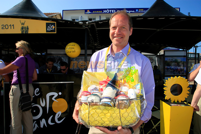 Christian Prudhomme, Tour Director, presented with a hamper of local produce at the sign on in Fromentine before the start of the 1st stage form Passage du Gois to Mont des Alouettes of the 2011 Tour de France, 2nd July 2011 (Photo by Eoin Clarke/NEWSFILE)