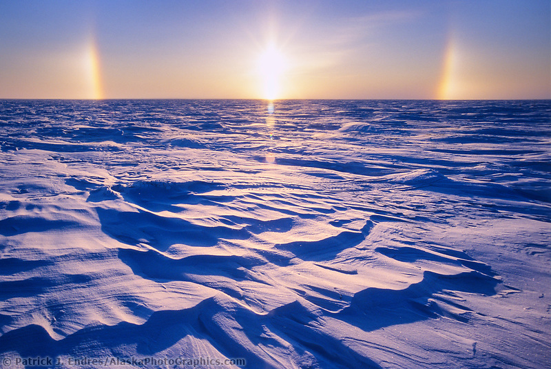 Snow Bow, near sunset, over wind blown snow on Alaska's Arctic Coastal Plains.